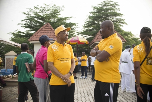 Director MTN Foundation, Mr. Dennis Okoro (left) chatted with Peter Nwaeke, Health Portfolio Manager, MTN Foundation, as they got ready for the #MTNASAP Walk